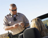 Nevada police officer issuing speeding ticket to driver