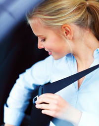 Woman wearing seat belt after completing online Texas seat belt course