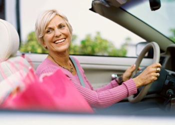 Happy Colorado driver who completed senior auto insurance discount program on the web